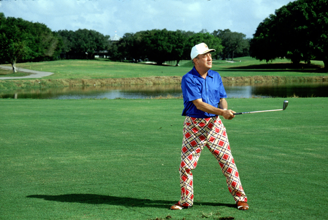 Full shot of Rodney Dangerfield as Al Czervik golfing.