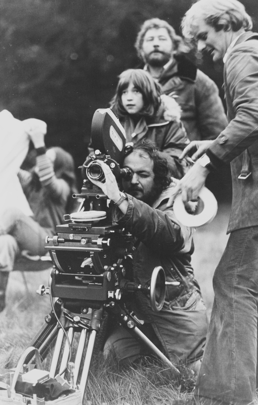 Full BTS shot of director Stanley Kubrick focusing camera, with daughter and crew members.