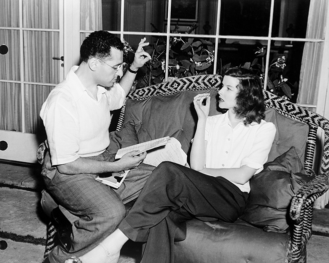 Director George Cukor and Katharine Hepburn discuss the script on the set of The Philadelphia Story.