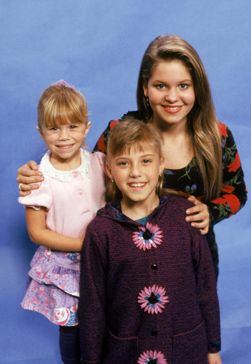 Medium shot of Candace Cameron Bure as D.J. Tanner, Mark-Kate/Ashley Olsen as Michelle Tanner, Jodie Sweetin as Stephanie Tanner.