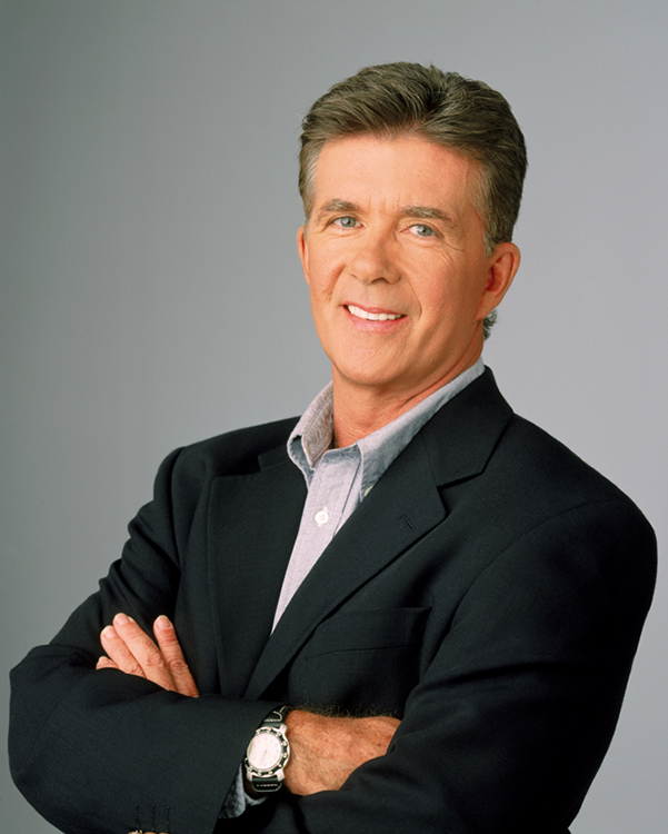 Alan Thicke wearing a blue blazer with his arms crossed