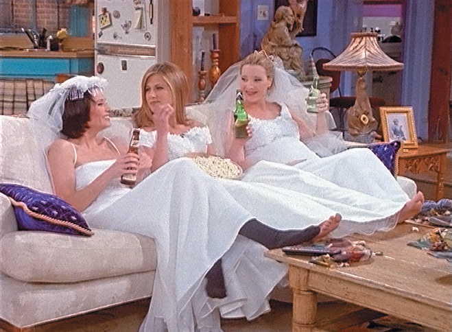 Monica, Rachel and Phoebe drinking beer and wearing wedding dresses