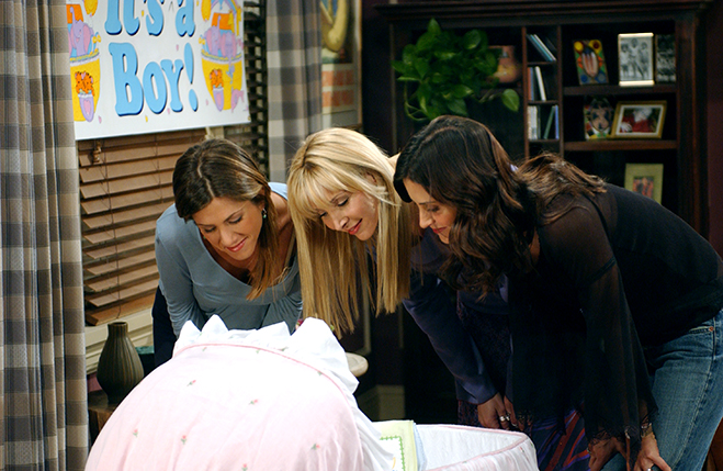 Rachel, Phoebe and Monica watch baby Emma sleeping in her bassinet