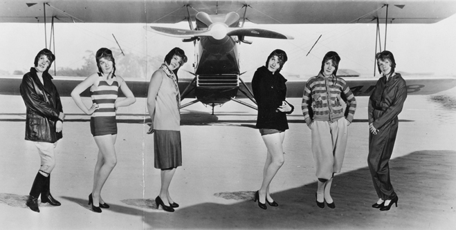 Full shot composite of six Anita Pages' standing in front of a backing with an airplane, modeling the latest in various sportswear, circa 1928.