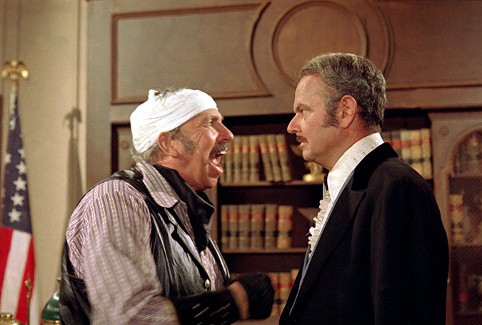 Slim Pickens as Taggart faces his boss