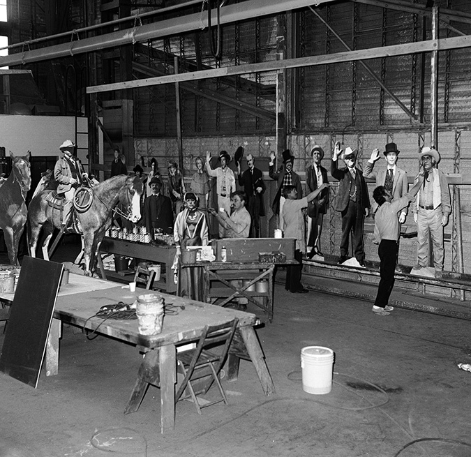Warner Bros Scenic Arts department working on wooden figures of the cast