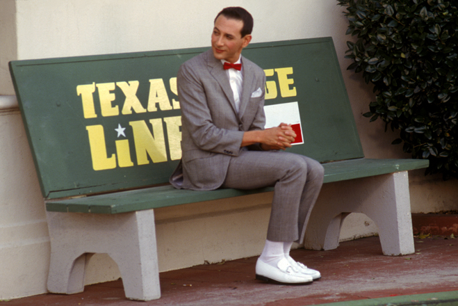 Full shot of Pee-Wee Herman as Himself, sitting on bench.