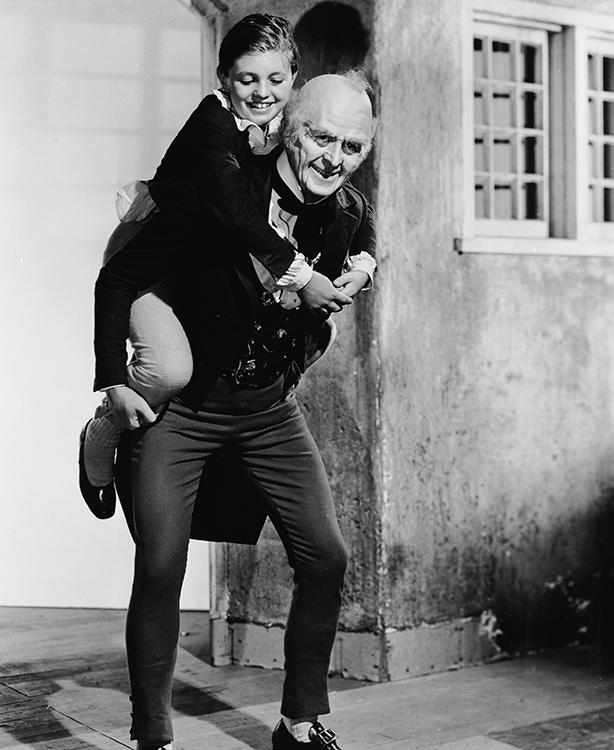 Reginald Owen as Ebenezer Scrooge with Terry Kilburn as Tiny Tim