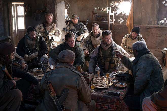 Michael Peña as Sam Diller, Thad Luckinbill as Vern Michaels, Michael Shannon as Cal Spencer, Jack Kesy as Charles Jones, Geoff Stults as Sean Coffers, Chris Hemsworth as Captain Nelson and Austin Hérbert as Pat Essex listen to Navid Negahban as Dostum.