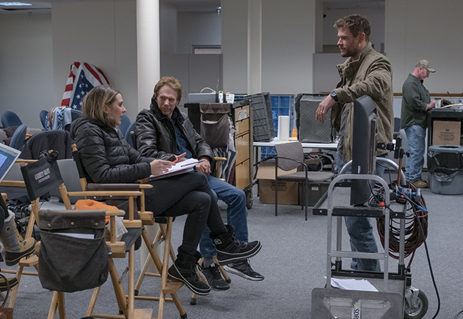 Producers Molly Smith and Jerry Bruckheimer discuss a scene with Chris Hemsworth on the set of 12 Strong.