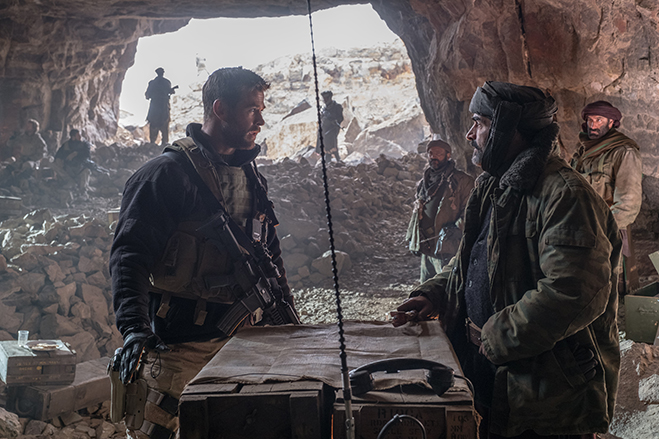 "Chris Hemsworth as Captain Mitch Nelson and Navid Negahban as General Dostum are unlikely allies in the true story of ""12 Strong""."