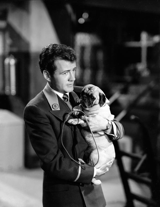 Robert Walker as Jimmy Dobson holding a dog.