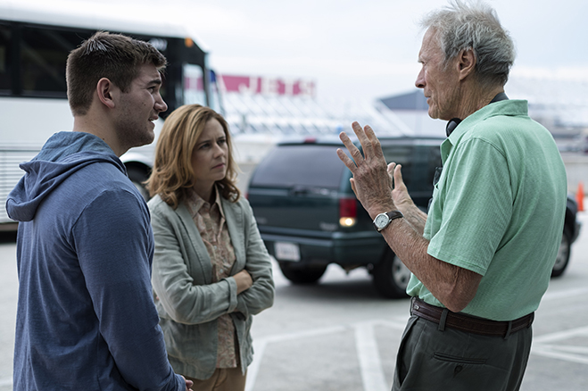 "Director Clint Eastwood discusses a scene with ALEK SKARLATOS and JENNA FISCHER on the set of ""The 15:17 to Paris"""
