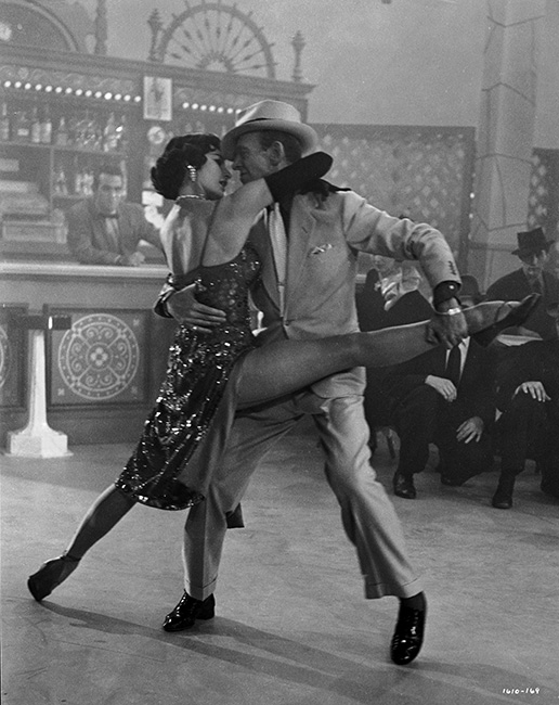 "Cyd Charisse as Gabrielle Gerard/The Brunette dancing with Fred Astaire as Tony Hunter during ""Girl Hunt Ballet"" musical number."