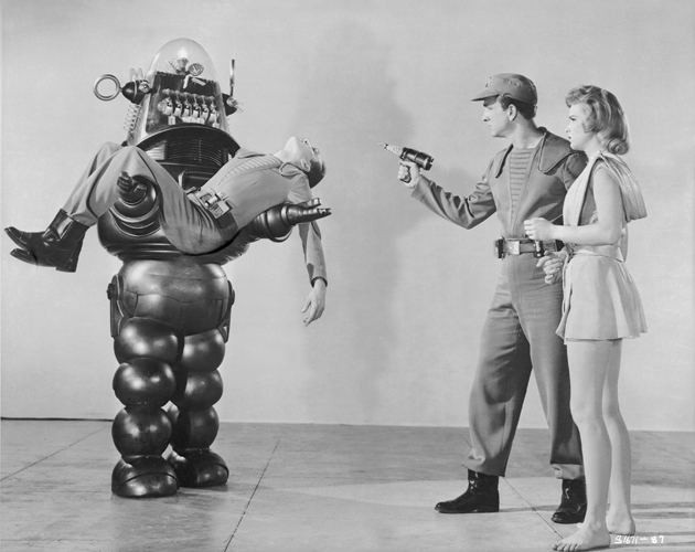 Publicity shot of robot and cast from Forbidden Planet