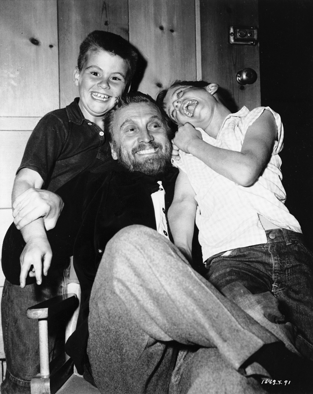 Medium BTS shot of Joel (left) and Michael Douglas visiting father Kirk Douglas, who plays Vincent van Gogh on set.