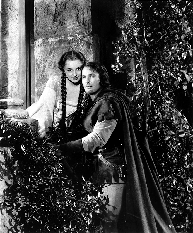 Errol Flynn as Robin Hood and de Havilland as Maid Marian on the set of the 1938 classic.