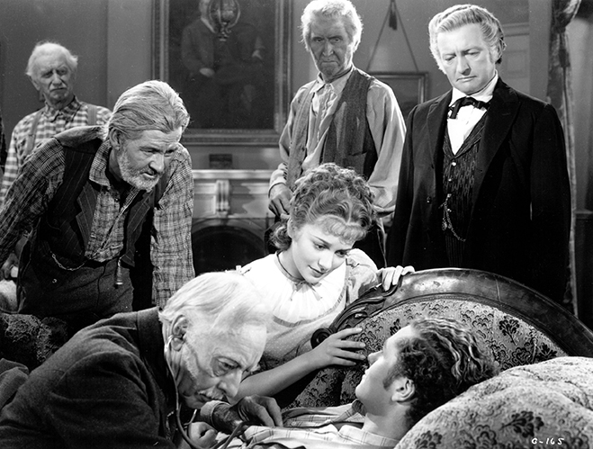 Olivia is surrounded by Harry Davenport, Tim Holt and Claude Rains in this gold rush drama.