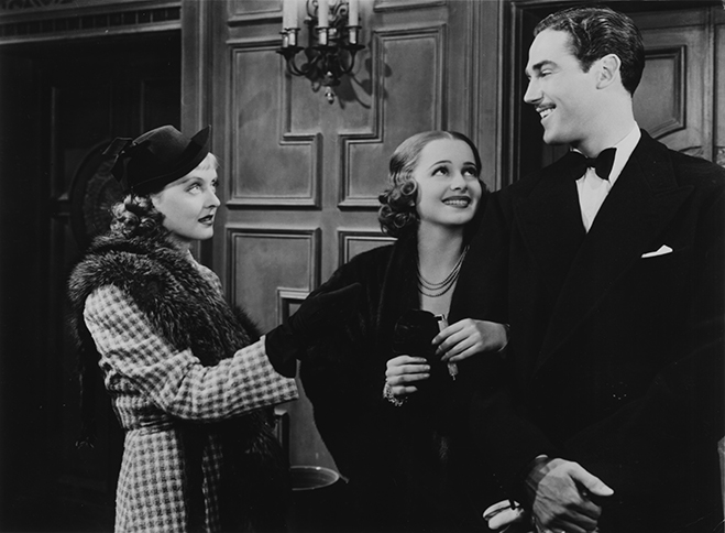 Bette Davis, de Havilland and Patric Knowles in the romantic comedy, It's Love I'm After.