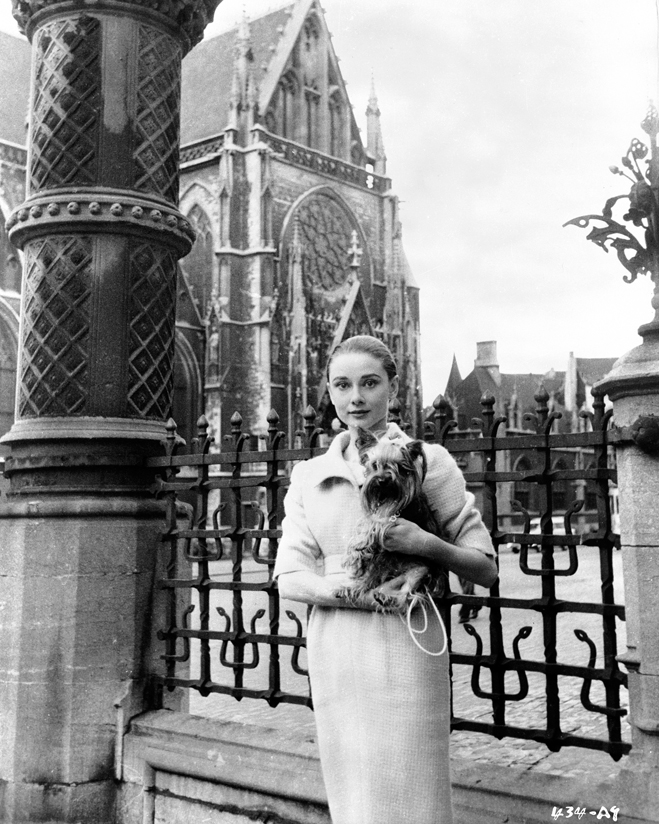 Audrey Hepburn sightseeing in Paris with her Yorkie Mr. Famous