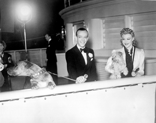 "Fred Astaire and Ginger Rogers about to shoot ""Walking the Dog"" sequence for Shall we Dance with two dogs"