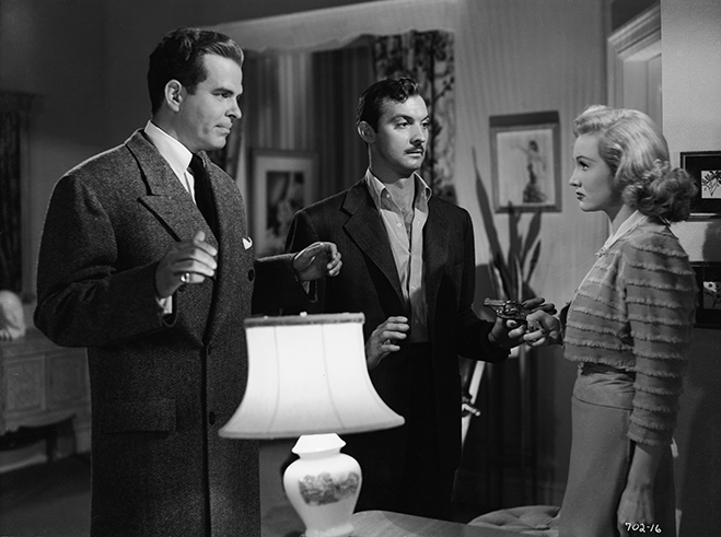 Douglas Kennedy with hands up next to Zachary Scott with hands up and Virginia Mayo as Flaxy Martin facing them holding a gun