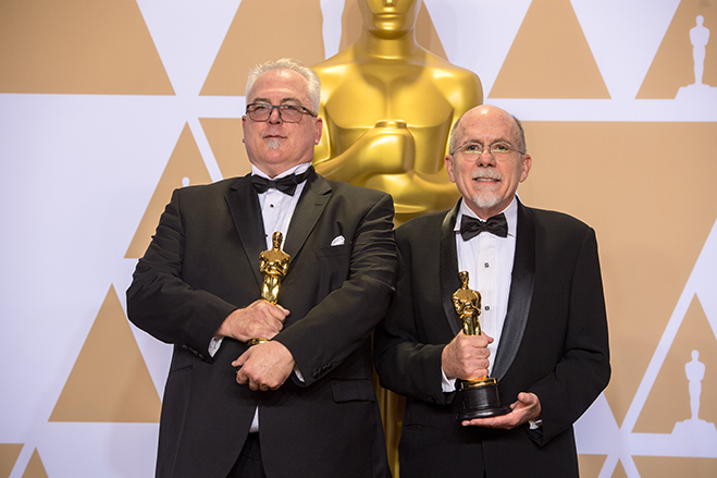 Alex Gibson and Richard King pose backstage with the Oscar for achievement in sound editing