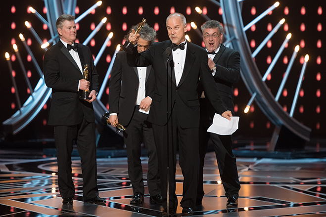 John Nelson, Gerd Nefzer, Paul Lambert, and Richard R. Hoover accept the Oscar for achievement in visual effects