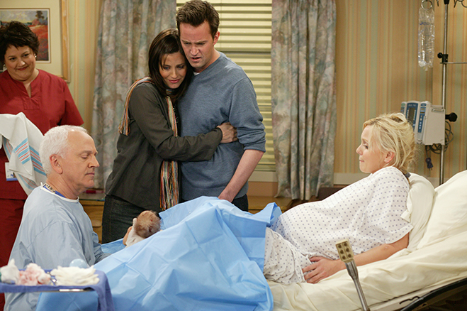 Monica and Chandler embrace as they watch the birth of their son