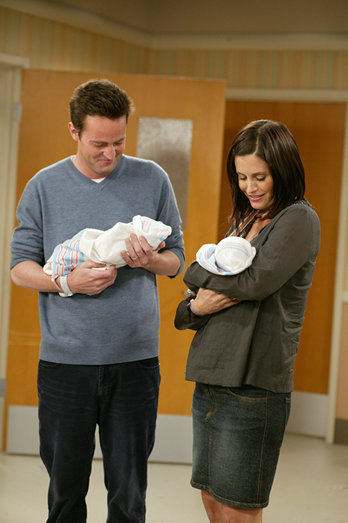 Chandler and Monica holding their newborn babies