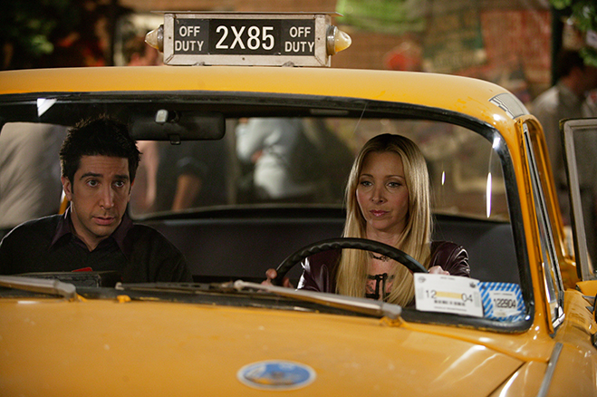 Medium shot of David Schwimmer as Ross sitting in taxi cab with Lisa Kudrow as Phoebe.