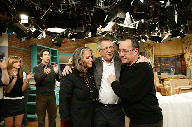 Medium BTS shot of Executive Producer Marta Kauffman, Director/Executive Producer Kevin Bright and Executive Producer David Crane in foreground, and Jennifer Aniston as Rachel and David Schwimmer as Ross in foreground.