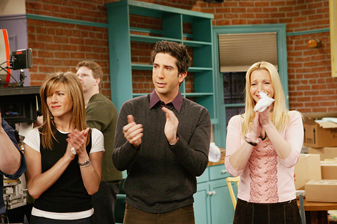 Medium BTS shot of cast taking curtain call: Jennifer Aniston as Rachel, David Schwimmer as Ross and Lisa Kudrow as Phoebe.