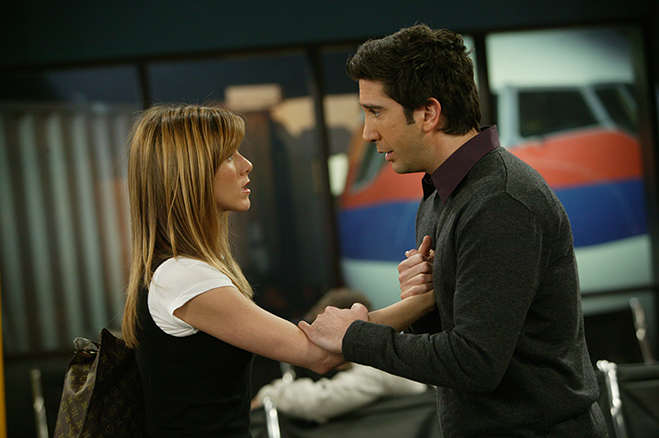 Medium profile shot in airport of Jennifer Aniston as Rachel and David Schwimmer as Ross.