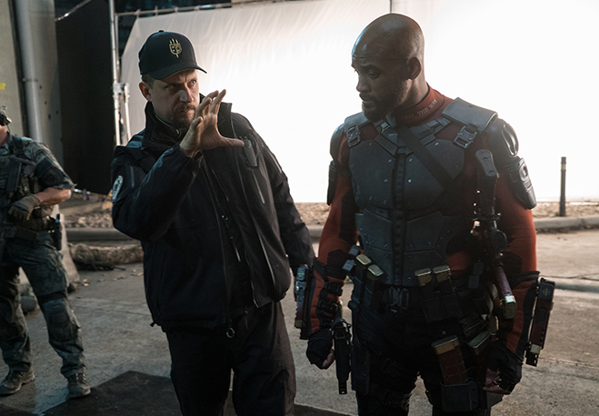 In this photo from the set, David Ayer directs Will Smith as Deadshot in Suicide Squad.