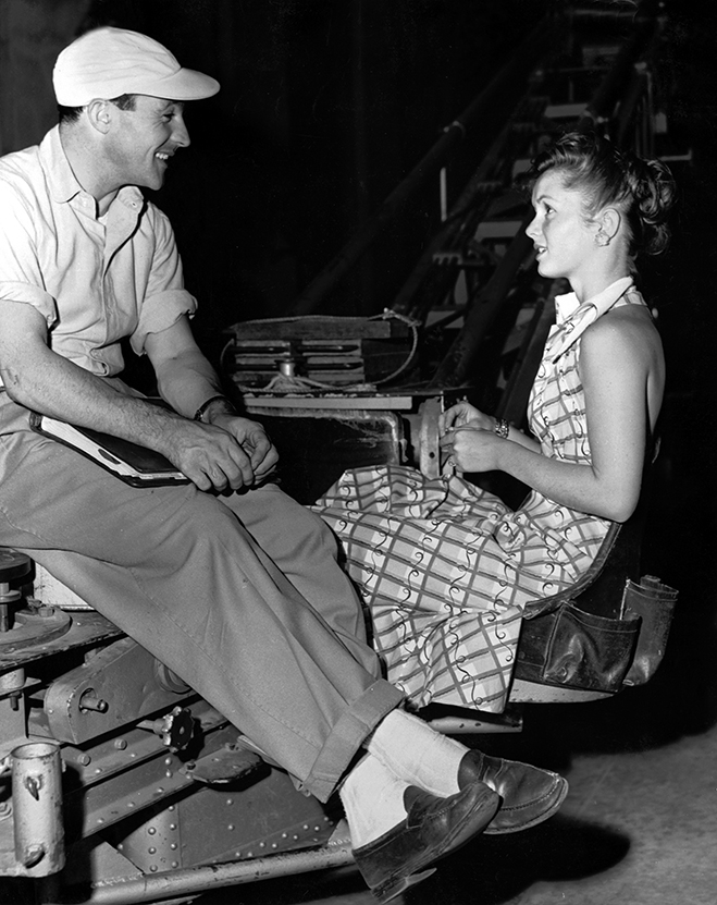 gene kelly and debbie reynolds on the set of singin' in the rain