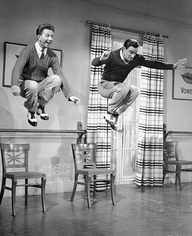donald o'connor and gene kelly get some serious air during rehearsals on the set of singin' in the rain