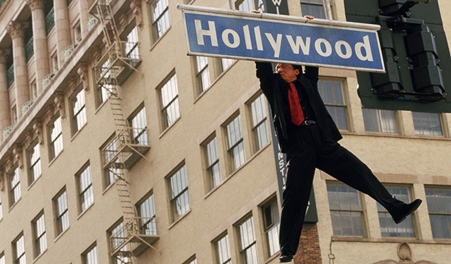 Jackie Chan hangs from the Hollywood Blvd. street sign in Rush Hour