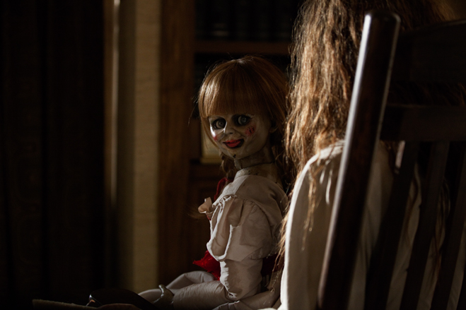 Annabelle sits on the lap of Bathsheba in The Conjuring
