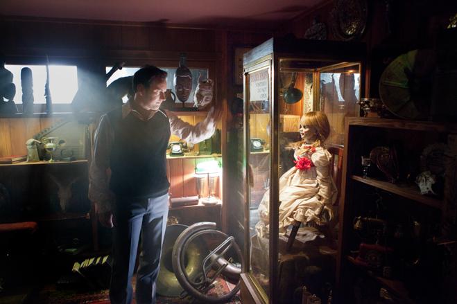 Patrick Wilson as Ed Warren looks in on Annabelle in her case