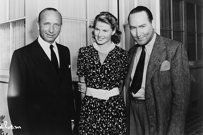 Director Michael Curtiz, star Ingrid Bergman and producer Hal B. Wallis on the set of Casablanca.