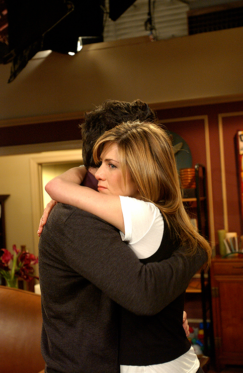Medium shot of David Schwimmer as Ross embracing Jennifer Aniston as Rachel.