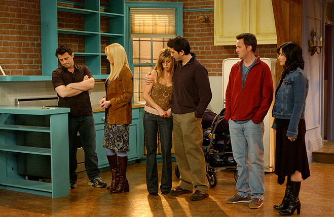 The cast of Friends in Monica's apartment
