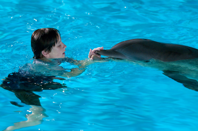Nathan Gamble with Winter the dolphin