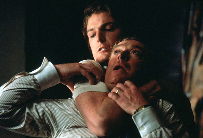 christopher reeve has michael caine in a choke-hold in a scene from the cat-and-mouse suspenser, Deathtrap