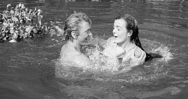 denny miller and joanna barnes share a moment in the water in 1959's tarzan the ape man