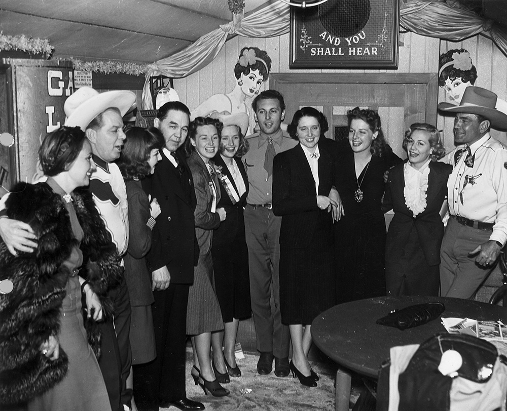 (L-R) Lya Lys, Hoot Gibson, Jean Parker, New Mexico Governor John Miles, Rosemary Lane, Priscilla Lane, Allan Jones, Susie Miles (the governor's wife), Ann Sheridan, Gloria Dickson, and Buck Jones