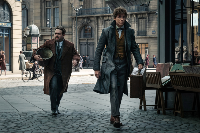 Dan Fogler as Jacob and Eddie Redmayne as Newt Scamander