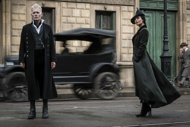 Johnny Depp as Grindelwald and Poppy Corby-Tuech as Vindy Rosider