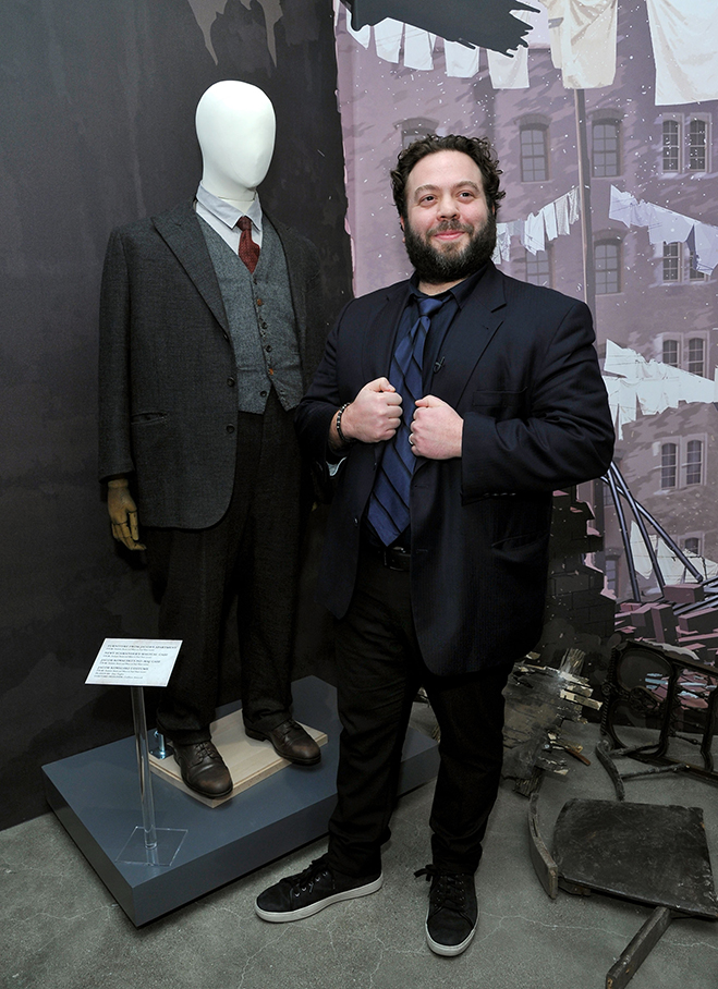 Actor Dan Fogler, who played Jacob Kowalski in Fantastic Beasts and Where to Find Them, poses with the costume he wore in the film during the recent media event.